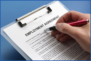 A client signing their employment agreement